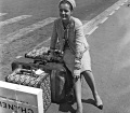 Romy Schneider wearing a tweed suit, two-tone shoes and the 2.55 bag in Paris in 1962 © Dalmas SIPA