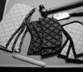 4. Lavorazione e creazione della 2.55 handbag by CHANEL© - Le diverse sezioni ottenute sono bordate con sottile gommapiuma