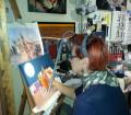 La bottega delle meraviglie, Donatella Carta (Violrojo) al lavoro su una tela